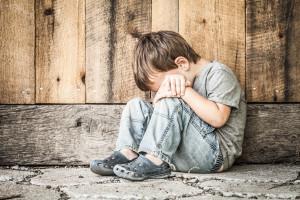 depressed homeless child on street
