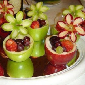 Green and red fruits carved into shapes