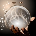 clairvoyant. woman looking into crystal ball on dark background