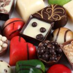 Selection of colorful chocolate candy in heart shape.