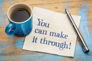 You can make it through! Handwriting on a napkin with a cup of espresso coffee.