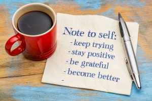 red coffee cup and napkin with words: Note to self: keep trying, stay positive, be grateful, become better