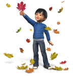 boy in blue sweater playing in Fall leaves