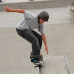 Young Boy in protective helmet Skateboarding