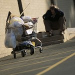 homeless person with shop cart